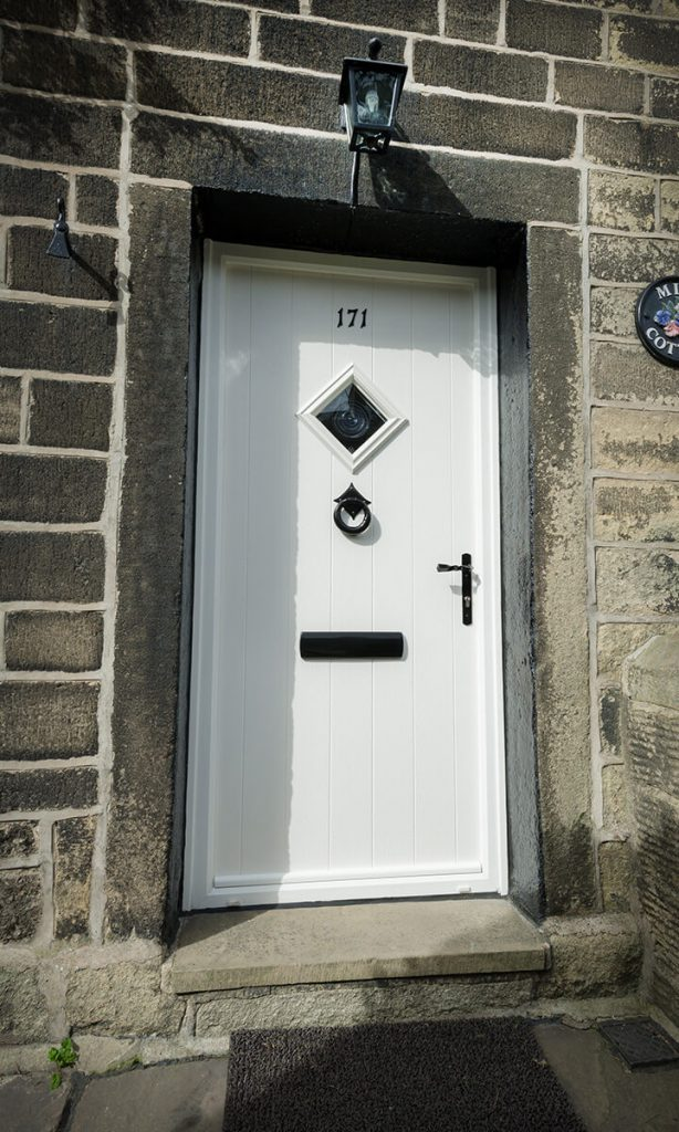 Traditional white composite front door installation