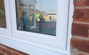 Close up of casement windows with chamfered frames